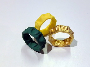 Half Hearted Ring ... a ring with a twist  in Polished Gold Steel