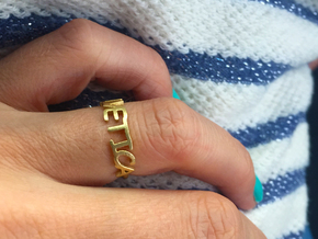 The Helvetica ring  (Size K, 50). in Raw Brass