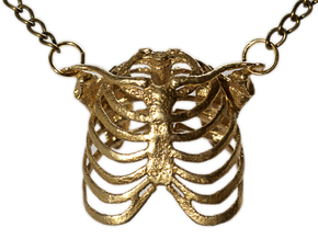 Ribcage pendant in Raw Brass