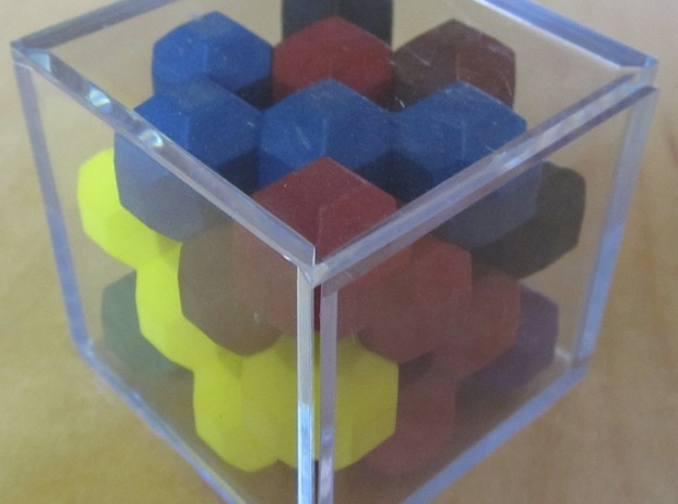 Ell of a puzzle 3d printed Solved puzzle in golf ball case.