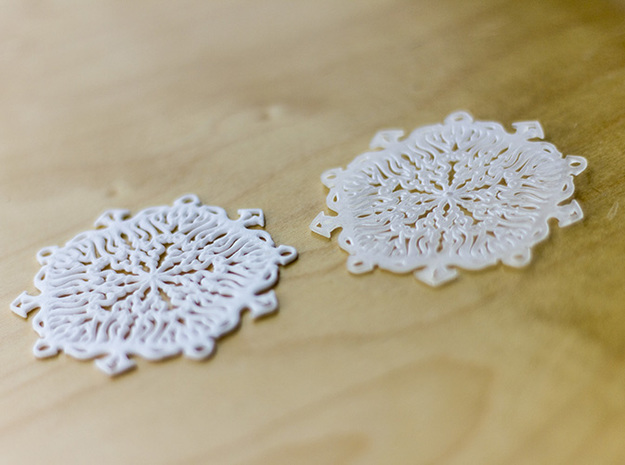 Snow Flake Earrings 3d printed Polished Strong & Flexible (left), Ultra Fine Detailed (right)