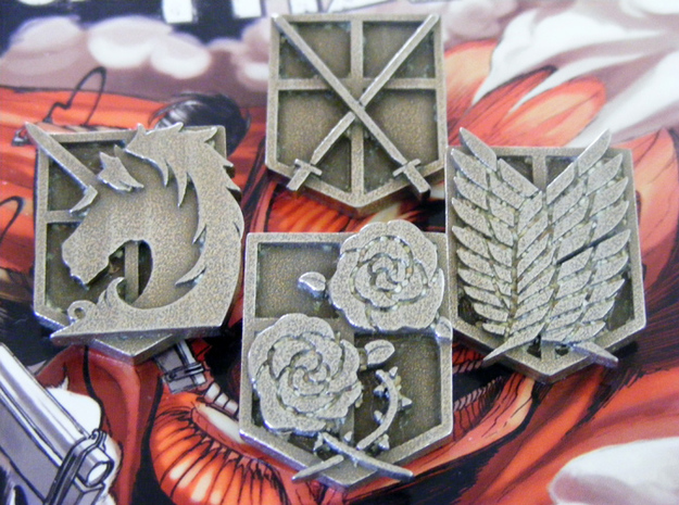 Attack On Titan Emblem - The Military Police 3d printed This shows how the emblem will arrive, with the support material still in the fine details. NOTE: You only receive one emblem with this item.