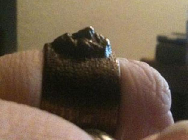 Creepy Face Ring size 9 3d printed Ring came out great in glossy bronze. Lots of detail. Here it is in profile.