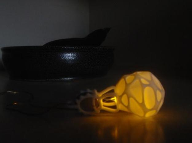 LED Pendant Ornament 3d printed Amber, glow, on the counter in darkness.