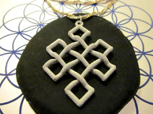 Endless Knot Pendant 3d printed Photo of Alumide pendant on a chain.