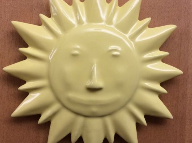 Ceramic Sun Decoration 3d printed Picture of yellow ceramic sun mounted to door.