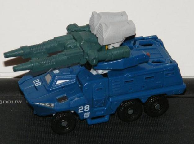 """Backlash"" Gunslinger figure 3d printed Gun mode, shown attached to a vehicle by clipping to a 3mm rail"