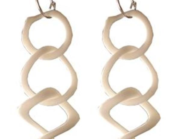 Tumbling loops earrings 3d printed In WSF Polished. They come with sterling silver ear hoops.