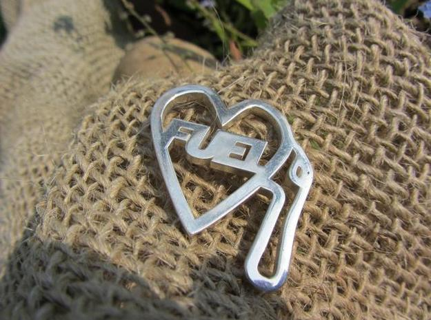 Love Pump Pendant 3d printed in silver
