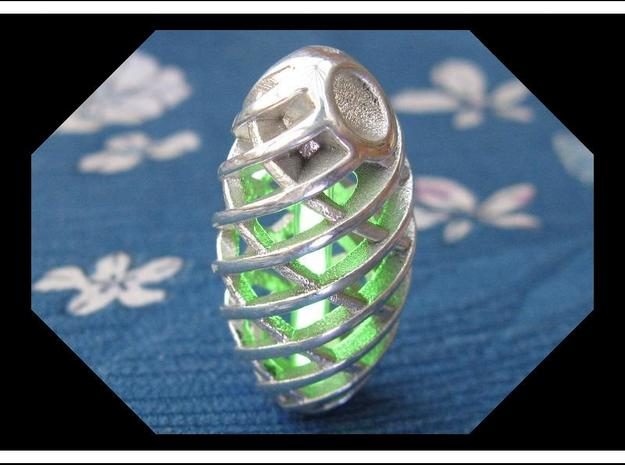 Tritium Pendant 1 (All Materials) 3d printed In this picture the phosphorus coating on the tritium vial is being energised by UV light.