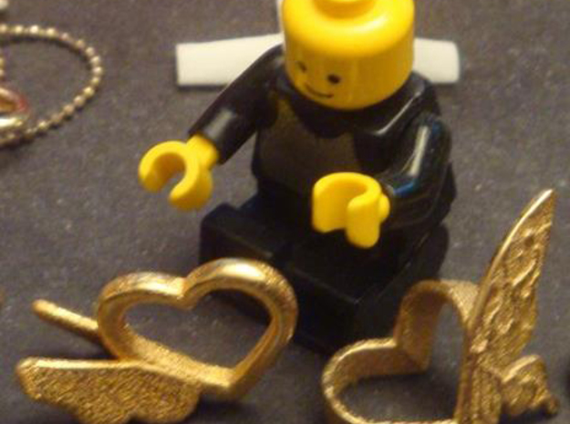 Sheryl heart trinket version 1 - single 3d printed Here is an image of the print next to a Lego man!