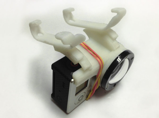 GoPro-Hero3 mount for arDrone2 3d printed top view of prototype - notice rubberband to hold camera. PS the shapeway print is much nicer looking than the prototype
