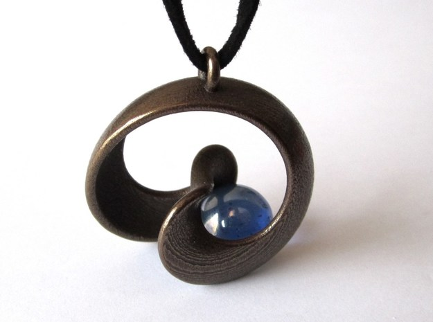 Half Mob-Tor: the half Mobius Torus Shell 3d printed in Antique Bronze (marble and necklace not included)