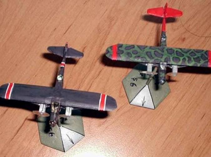Two painted models. Left model is in Transparent Detail. Right model is in WSF. Propeller disks added from clear plastic.