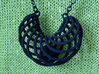 Pendant with captured bead 3d printed close up of pendant in black strong flexible
