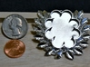 Laurels' Medallion 3d printed In polished silver with coins to scale by.