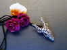 Dragon of Swirls 3d printed With awesome crystals and a couple mini-roses. Not for scale, just because they're cool.