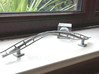 Schwarzkopf style barrel roll 3d printed Metallic plastic adorning the windowsill