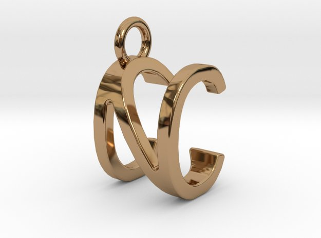 Two way letter pendant - CN NC in Polished Brass