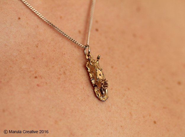 Doris the Nudibranch Pendant in Natural Brass
