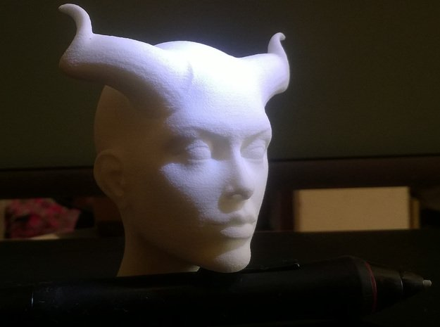 Beautiful Devil face in White Natural Versatile Plastic