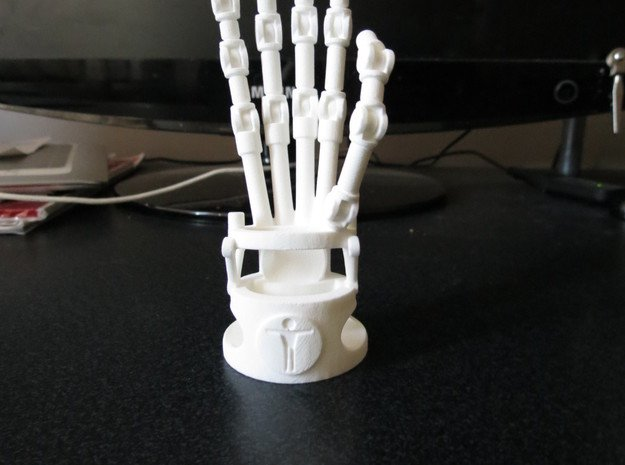 Robot hand phone stand in White Natural Versatile Plastic