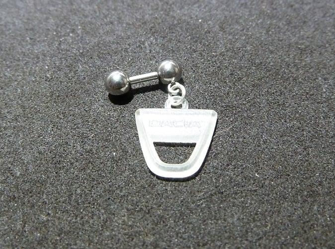 piercing barbell with Dacia logo