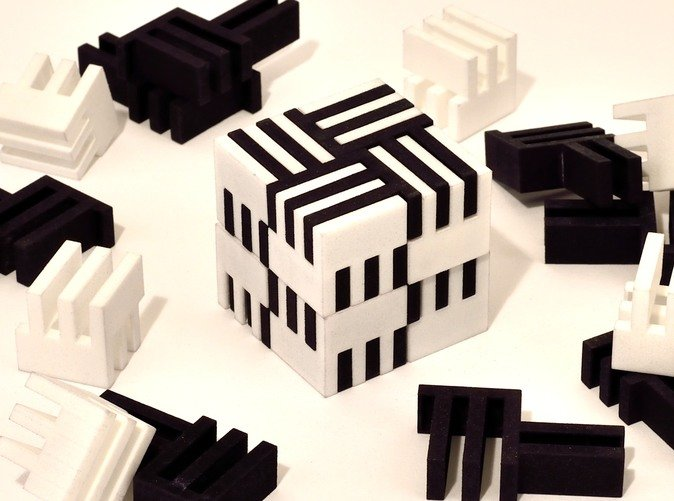 Eight black pieces for puzzle shown