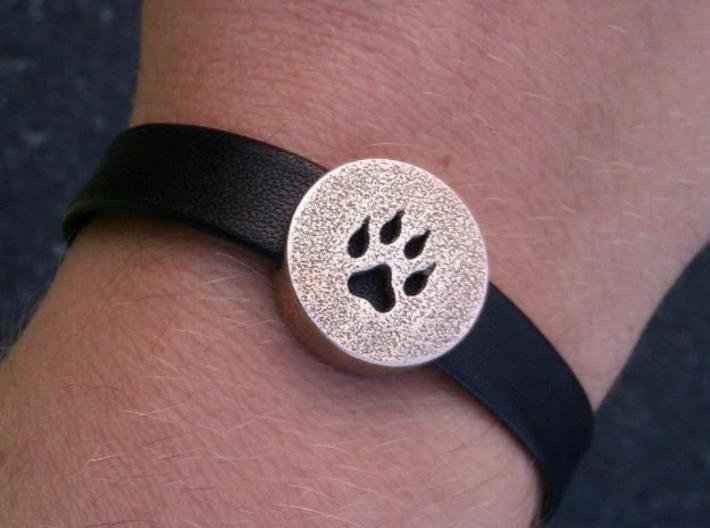 Band Charm round - Wolf Paw print 3d printed Example on a leather bracelet