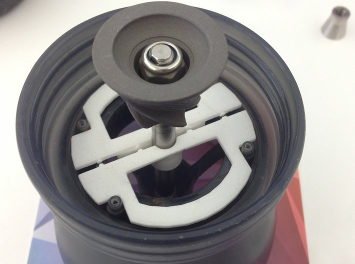 Hario Skerton Coffee Grinder Bottom Bracket 3d printed With the outer burr assembly removed, the bracket halves are placed as shown