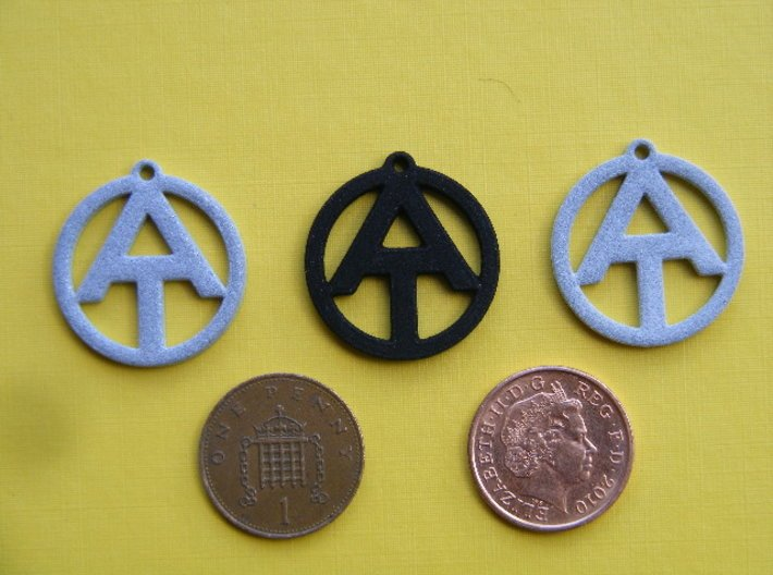 AT Dog Tag 3d printed Left to Right; Polished Alumide, Black/Strong/Flexible, Alumide
