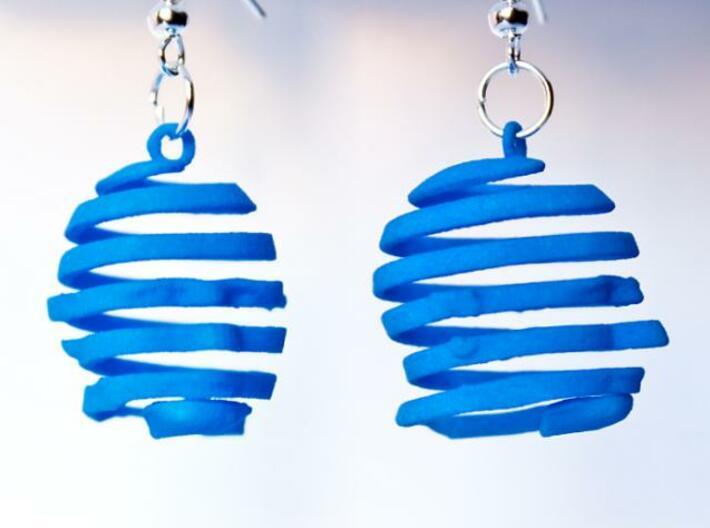 Escherian Head Earring 3d printed Printed in Summer Blue Strong & Flexible.