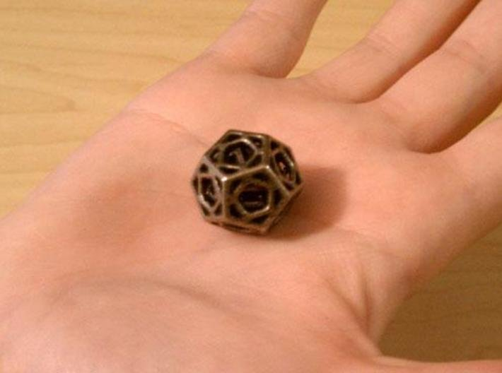 Cage d12 3d printed In stainless steel and inked.