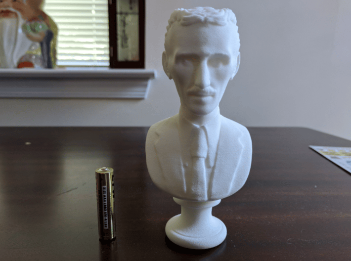 Nikola Tesla Bust Large 3d printed AAA Battery for scale.