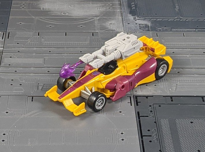 TF CW Dragstrip Slim Car Cannon 3d printed Mounted on the Car mode's top peg