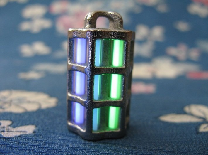 Tritium Lantern 5B (3x22.5mm Vials) 3d printed In this picture the phosphorus coating on the tritium vial being energised by UV light.