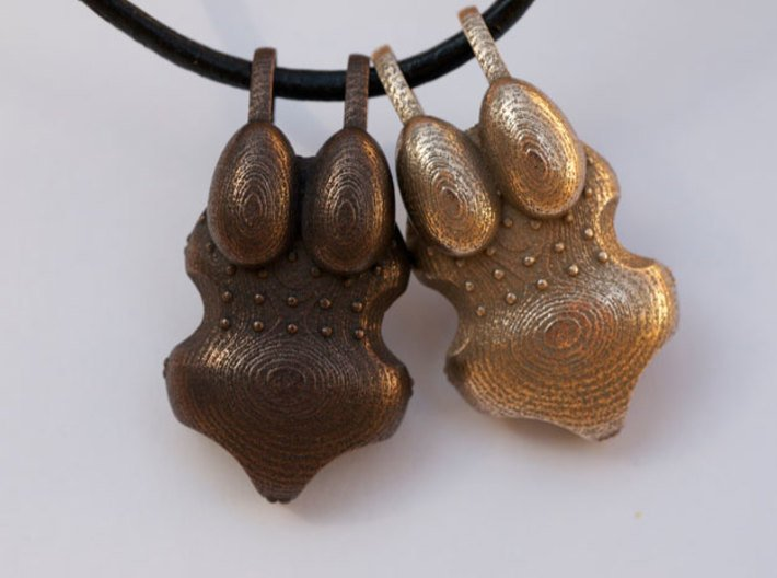 I Walk With #KubraKhademi Pendant 3d printed Stainless Steel (Right) Polished Bronze Steel (Left)