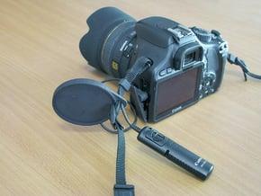 Holder for the camera lens cap . in Black Natural Versatile Plastic
