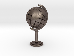 World Sculpture in Polished Bronzed Silver Steel