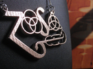 Four Symbols - Classic 70's Rock Pendant in Stainless Steel