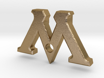 "Badge ""M"" (Film Wizardry) in Polished Gold Steel"