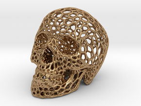 Human skull skeleton perforated sculpture in Polished Brass