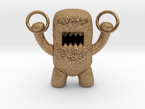 Domo Monster doing exercises with rings in Polished Brass