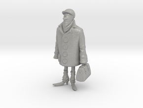 Man holding a suitcase in Aluminum