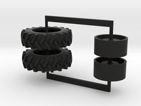 16.9-34 drive tires in Black Natural Versatile Plastic