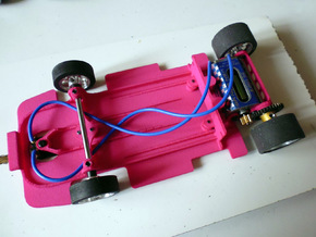 Slot car chassis for FXX 1/28 in Pink Processed Versatile Plastic