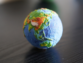 Topographic Earth relief globe in Full Color Sandstone