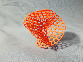 Enneper surface irregular holes weave in Orange Strong & Flexible Polished