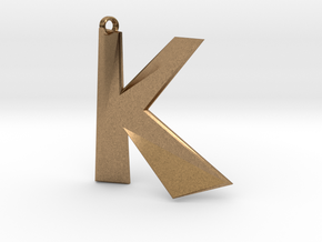 Distorted letter K in Natural Brass