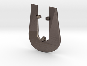Distorted letter U in Polished Bronzed Silver Steel